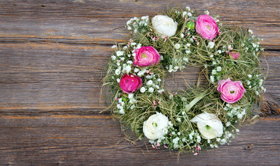 Summer flower wreath on wooden background