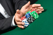 "Gambler stakes ""all in"" pushing his chips forward"