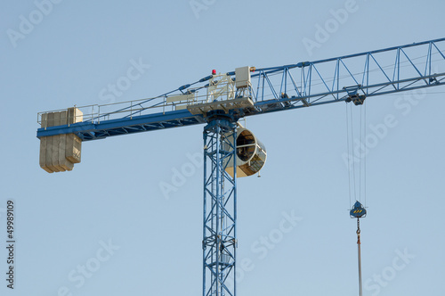 Construction crane - building a house