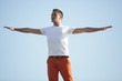 Stock image of a man with arms outstretched