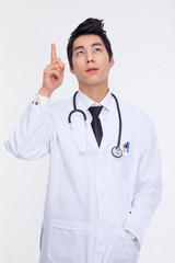 Young Asian doctor indicate upside