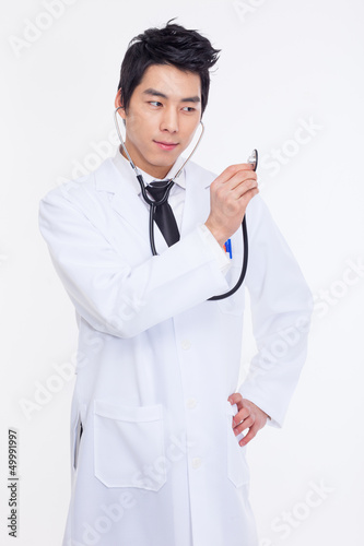 Young Asian doctor using stethoscope