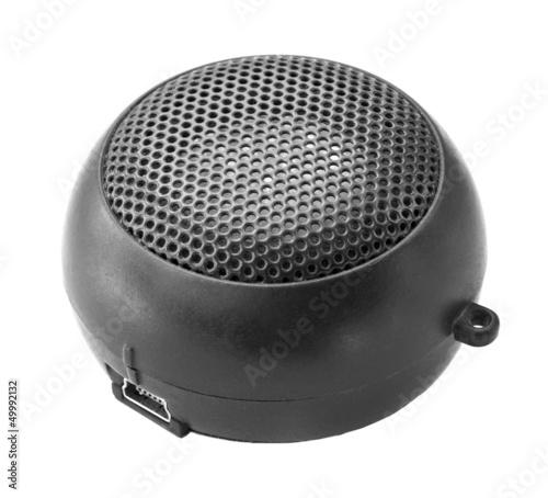 Portable mini speaker on a white background.