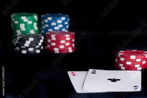 two aces high on black table with chips