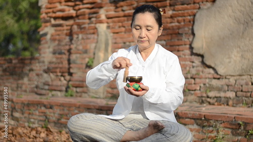 Woman playing a tibetan bowl, used to aid meditation