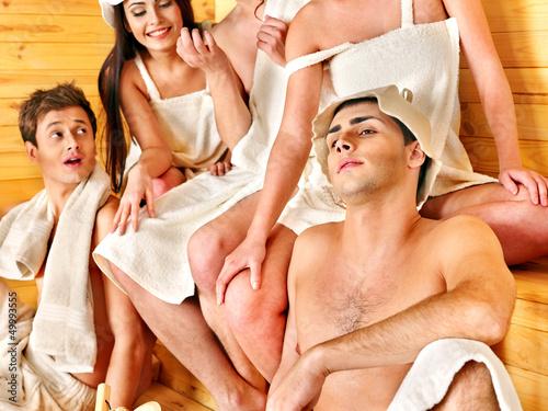 Group people in Santa hat  at sauna.