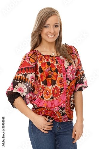 Smiling woman in trendy blouse