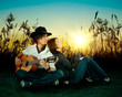 Love story. A young man playing guitar for his girl.