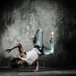 Young b-boy man doing brake dancing movements