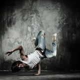 Fototapety Young b-boy man doing brake dancing movements