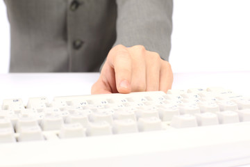 Office hand presses a button on the keyboard.