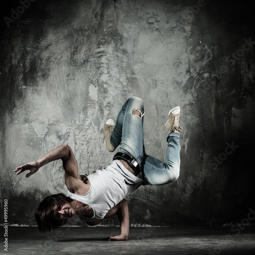 Young b-boy man doing brake dancing movements