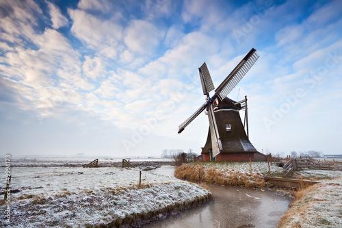 Dutch windmill and cloudscape