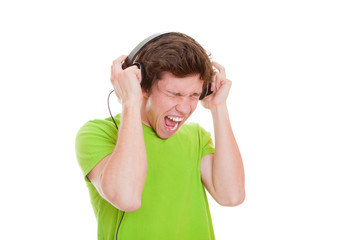 teen singing with headphones