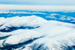 Aerial view of snowy winter mountains Yukon Canada