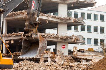 Destruction of concrete building with equipment