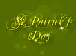 Irish shamrocks leaves background with text St. Patrick's Day. E