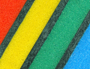 Colorful sponges for washing dishes. Abstract background.