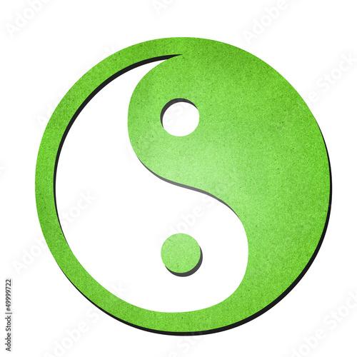 green ying yang symbol paper art on white