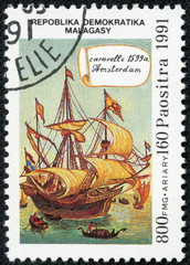 stamp printed in Malagasy  shows caravelle Amsterdam, 1599