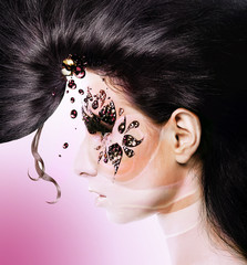 pink flower woman with creative hair and face art with rhineston