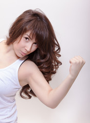 Attractive woman making a fist