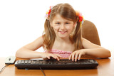 little girl playing with keyboard looking at camera like in moni