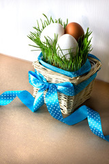 Background with easter eggs and green grass