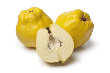 Fresh whole and half yellow Quinces