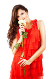 woman in red dress with long curly hair and white rose in hands