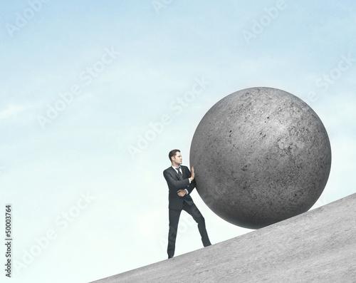 man pushing ball