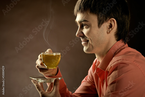 beautiful man with tea