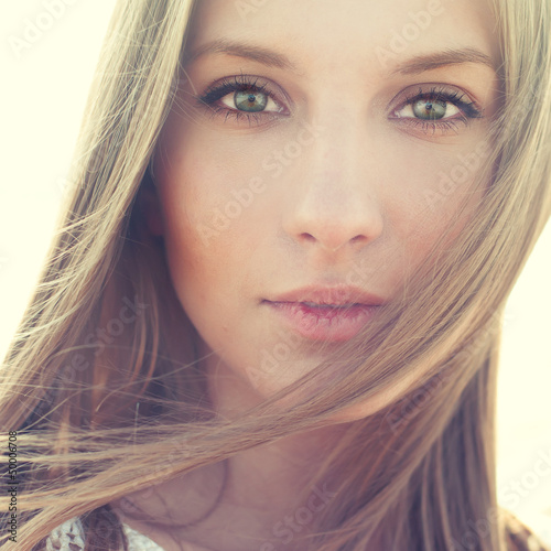 portrait of a beautiful girl closeup. pictures in warm colors