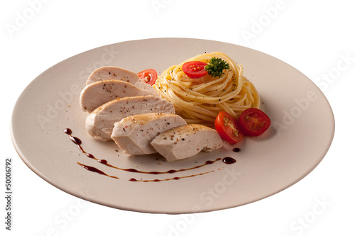 Chicken with macaroni isolated over white background