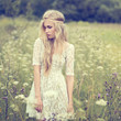 beautiful young girl in a summer field