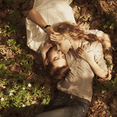 beautiful couple lying in a meadow in spring