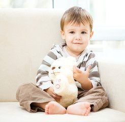Portrait of a little boy with his teddy bear