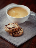 Cup of cafe crema with chocolate chip cookies