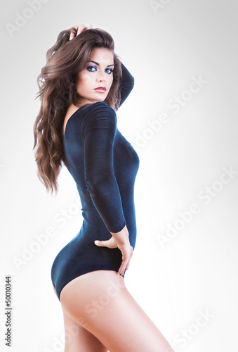 sensual brunette woman in blue body