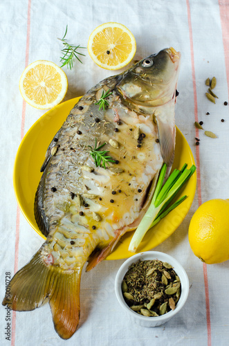Fresh carp with lemon and spices