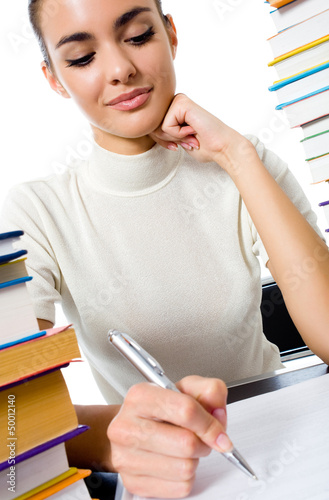 Writing woman with textbooks, isolated