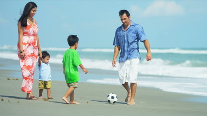 Latin American family spending holiday on beach