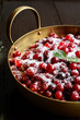 Wild cranberries with sugar in metal bowl
