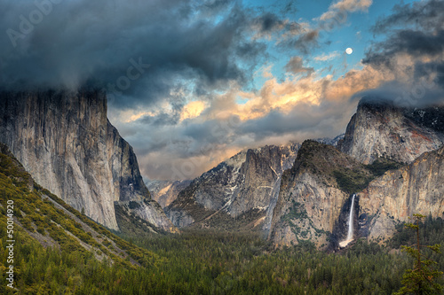 Tunnel View during a clearing storm with the moon rising