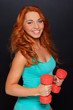 Redhead woman on the black background