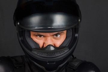 Man in bikers helmet with a defiant facial expression