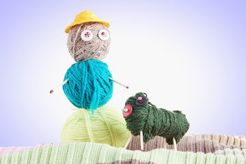 Man With A Dog. Conceptual Photo With Toys Made Of Balls Of Yarn