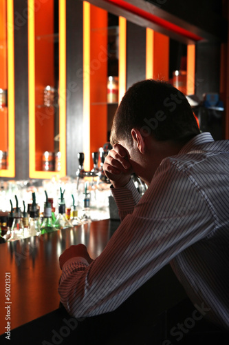 Sad Young Man at the Bar