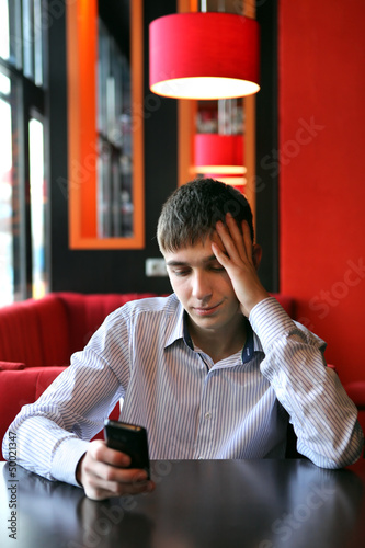 Sad Young Man With Phone