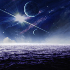 Planets in night sky over moonlit water